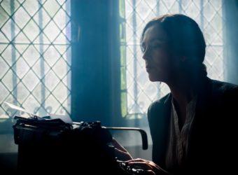 Woman writing on a typewriter