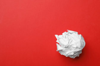 Crumpled sheet of paper on color background, top view. Space for text